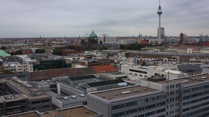 Skyline of central Berlin with the TV Tower at Alexanderplatz and view of Potsdamer Platz as well as rooftops and churches.