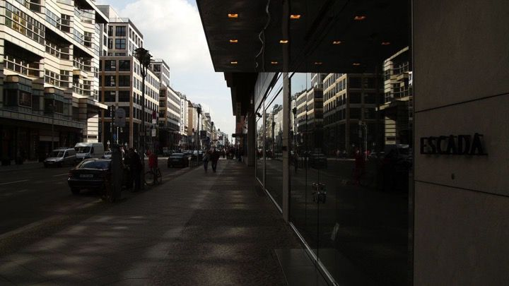 Sidewalk street view in Berlins Friedrichstrasse near shopping and fashion spots, Galeries Lafayettes and Checkpoint Charlie.